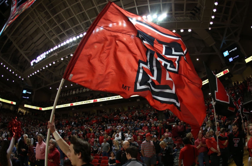 Jan 31, 2018; Lubbock, TX, USA; A Texas Tech Red Raiders cheerleader brings the team flag onto the court before the game against the Texas Longhorns at United Supermarkets Arena. Mandatory Credit: Michael C. Johnson-USA TODAY Sports