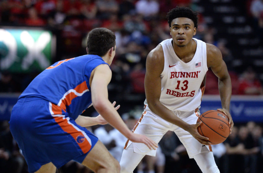 Mar 5, 2020; Las Vegas, Nevada, USA; UNLV Rebels guard Bryce Hamilton (13) look to pass the ball defended by Boise State Broncos guard Justinian Jessup (3) during the first half of a Mountain West Conference tournament game at Thomas Mack Center. Mandatory Credit: Orlando Ramirez-USA TODAY Sports
