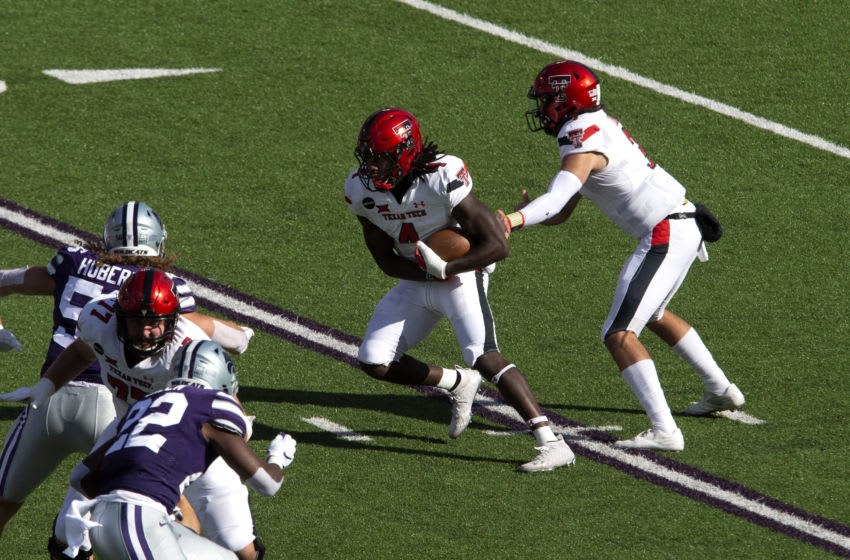 Oct 3, 2020; Manhattan, Kansas, USA; Texas Tech Red Raiders quarterback Henry Colombi (3) hands off to running back SaRodorick Thompson (4) during a game against the Kansas State Wildcats at Bill Snyder Family Football Stadium. Mandatory Credit: Scott Sewell-USA TODAY Sports