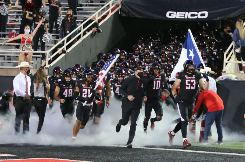 Oct 31, 2020; Lubbock, Texas, USA; Texas Tech Red Raiders head coach Matt Wells leads the team onto the field before the game against the Oklahoma Sooners at Jones AT&T Stadium. Mandatory Credit: Michael C. Johnson-USA TODAY Sports