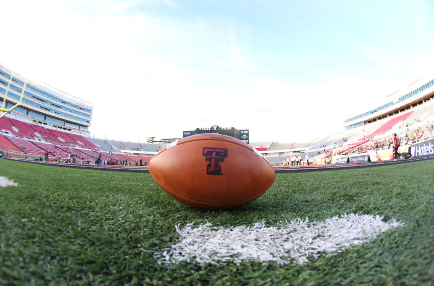 Oct 31, 2020; Lubbock, Texas, USA; A Texas Tech Red Raiders football sits on the field before the game against the Oklahoma Sooners at Jones AT&T Stadium. Mandatory Credit: Michael C. Johnson-USA TODAY Sports