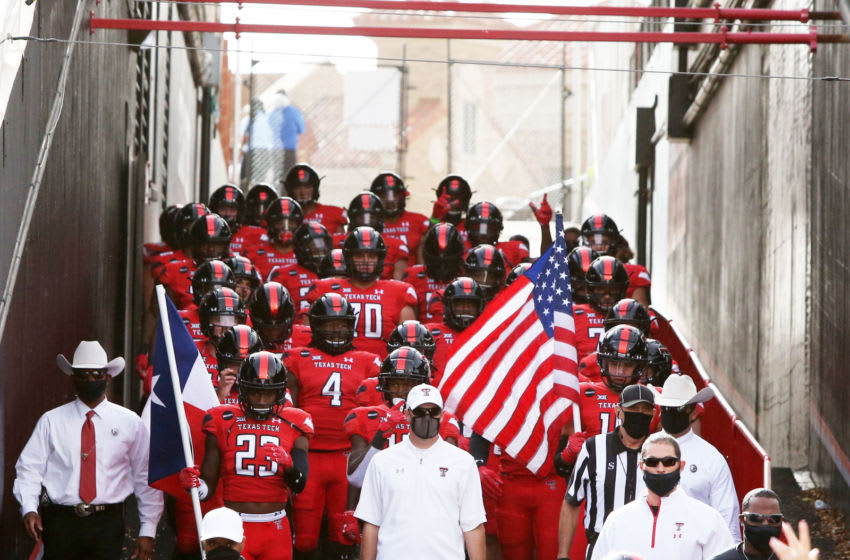 Nov 14, 2020; Lubbock, Texas, USA; Texas Tech Red Raiders head coach Matt Wells leads the team to the field before the game against the Baylor Bears at Jones AT&T Stadium. Mandatory Credit: Michael C. Johnson-USA TODAY Sports