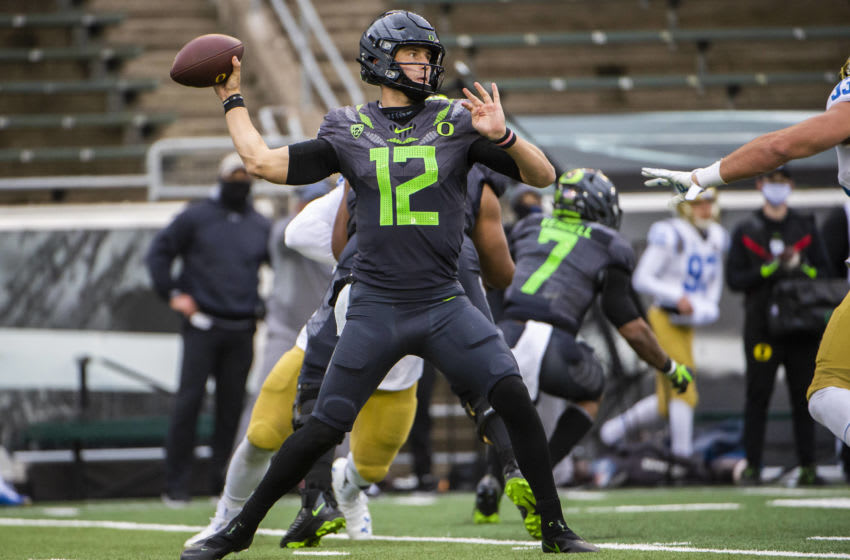 Nov 21, 2020; Eugene, Oregon, USA; Oregon Ducks quarterback Tyler Shough (12) throws a pass during the second half against the UCLA Bruins at Autzen Stadium. The Ducks won 38-35. Mandatory Credit: Troy Wayrynen-USA TODAY Sports