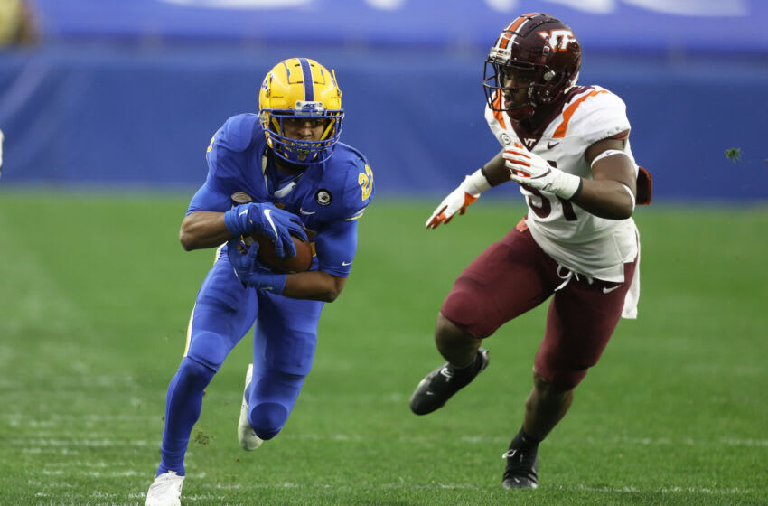Nov 21, 2020; Pittsburgh, Pennsylvania, USA; Pittsburgh Panthers running back Vincent Davis (22) runs after a catch as Virginia Tech Hokies defensive lineman Robert Wooten (51) chases during the first quarter at Heinz Field. Pittsburgh won 47-14. Mandatory Credit: Charles LeClaire-USA TODAY Sports