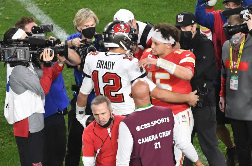 Feb 7, 2021; Tampa, FL, USA; Tampa Bay Buccaneers quarterback Tom Brady (12) greets Kansas City Chiefs quarterback Patrick Mahomes (15) after Super Bowl LV at Raymond James Stadium. Mandatory Credit: James Lang-USA TODAY Sports