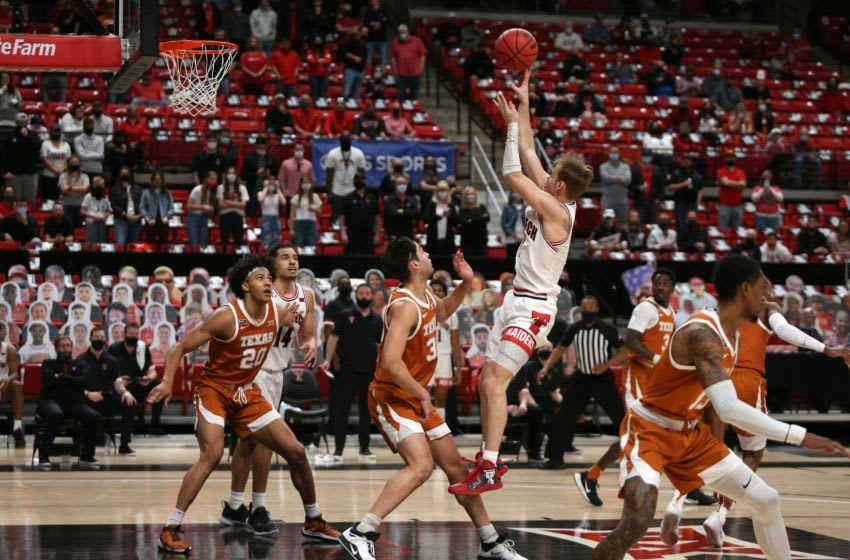 Feb 27, 2021; Lubbock, Texas, USA; Texas Tech Red Raiders guard Mac McClung (0) takes a jump shot over Texas Longhorns forward Brock Cunningham (30) in the second half at United Supermarkets Arena. Mandatory Credit: Michael C. Johnson-USA TODAY Sports