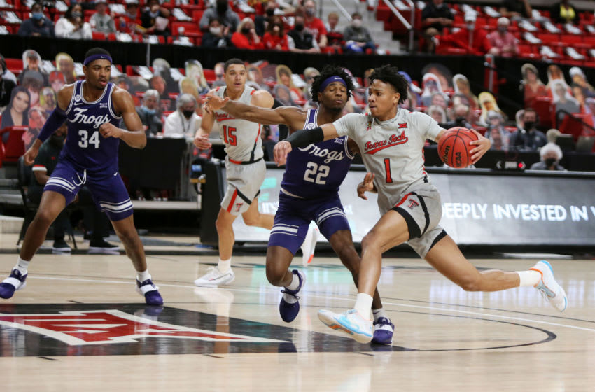 Mar 2, 2021; Lubbock, Texas, USA; Texas Tech Red Raiders guard Terrence Shannon Jr. (1) drives to the basket against Texas Christian Horned Frogs guard RJ Nembhard (22) in the second half at United Supermarkets Arena. Mandatory Credit: Michael C. Johnson-USA TODAY Sports