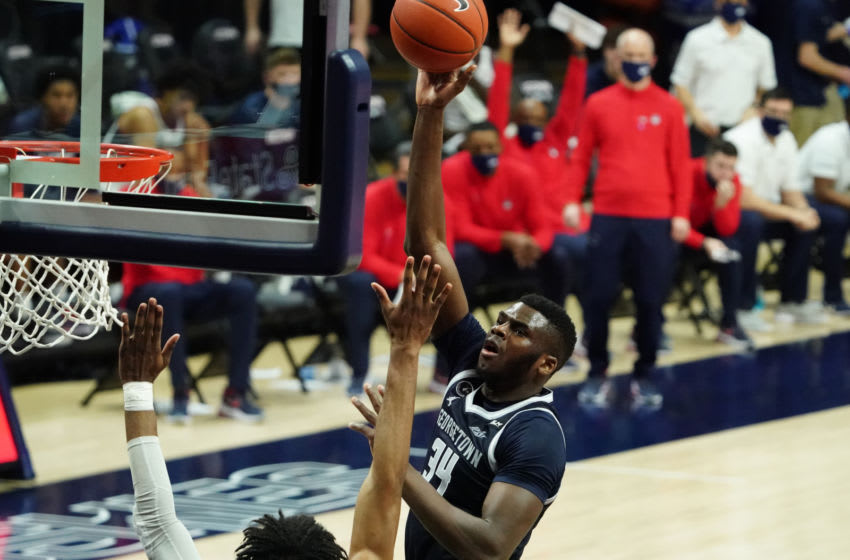 Mar 6, 2021; Storrs, Connecticut, USA; Georgetown Hoyas center Qudus Wahab (34) shoots against Connecticut Huskies forward Isaiah Whaley (5) during the second half at Harry A. Gampel Pavilion. UConn defeated Georgetown 98-82. Mandatory Credit: David Butler II-USA TODAY Sports