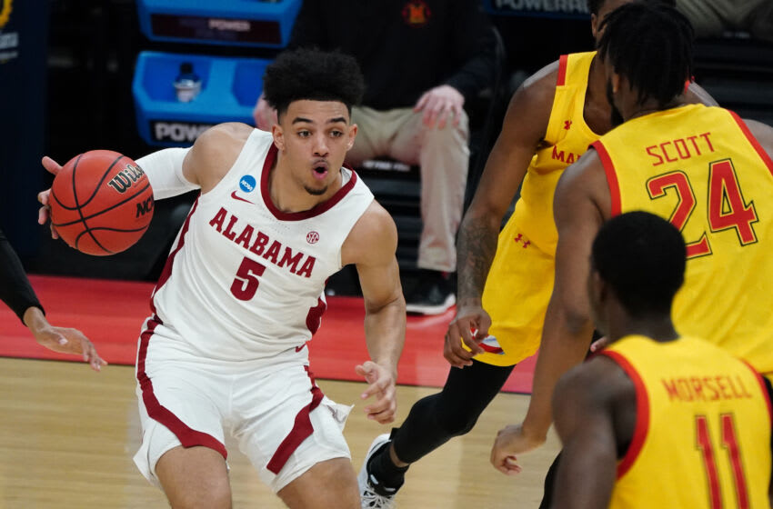 Mar 22, 2021; Indianapolis, Indiana, USA; Alabama Crimson Tide guard Jaden Shackelford (5) drives against Maryland Terrapins forward Donta Scott (24) in the first half in the second round of the 2021 NCAA Tournament at Bankers Life Fieldhouse. Mandatory Credit: Kirby Lee-USA TODAY Sports