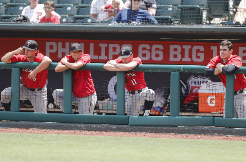 May 28, 2021; Oklahoma City, Oklahoma, USA; Texas Tech bench watches game action against Kansas State in the fourth inning at the Big 12 Conference Baseball Tournament at Chickasaw Bricktown Ballpark. Mandatory Credit: Alonzo Adams-USA TODAY Sports