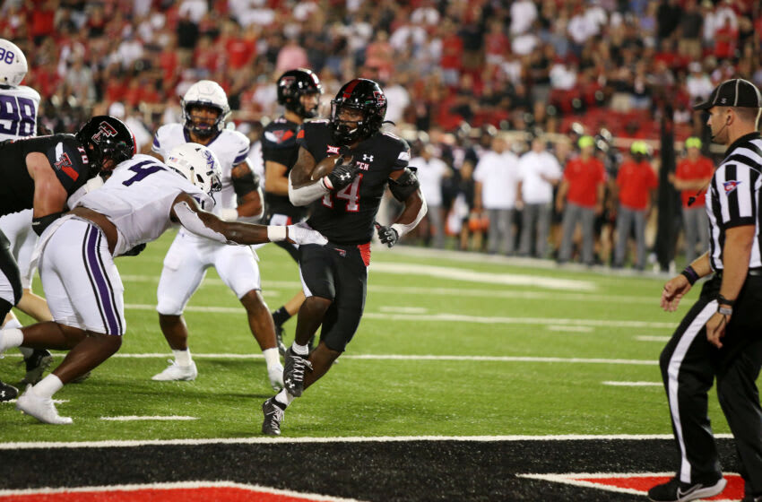 Sep 11, 2021; Lubbock, Texas, USA; Texas Tech Red Raiders running back Xavier White (14) scores a touchdown against the Stephen F. Austin Lumberjacks in the second half at Jones AT&T Stadium. Mandatory Credit: Michael C. Johnson-USA TODAY Sports