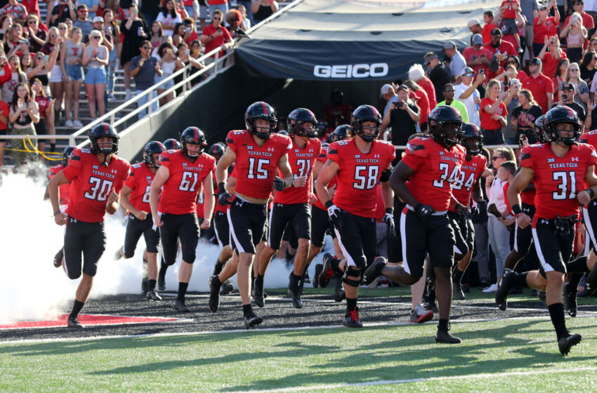 Sep 18, 2021; Lubbock, Texas, USA; Texas Tech Red Raiders players run onto the field before the game against the Florida International Panthers at Jones AT&T Stadium. Mandatory Credit: Michael C. Johnson-USA TODAY Sports