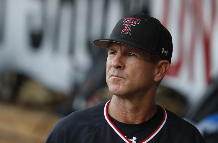 Jun 19, 2019; Omaha, NE, USA; Texas Tech Red Raiders head coach Tim Tadlock looks out from the dugout prior to the game against the Florida State Seminoles in the 2019 College World Series at TD Ameritrade Park. Mandatory Credit: Bruce Thorson-USA TODAY Sports