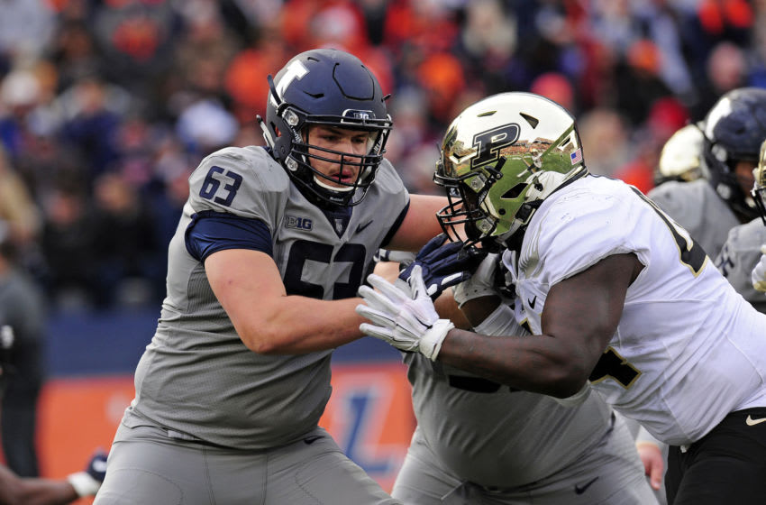 CHAMPAIGN, IL - OCTOBER 13: Illinois Fighting Illini offensive lineman AlexPalczewski (63) works against Purdue Boilermakers defensive tackle Anthony Watts (44) during the Big Ten Conference college football game between the Purdue Boilermakers and the Illinois Fighting Illini on October 13, 2018, at Memorial Stadium in Champaign, Illinois. (Photo by Michael Allio/Icon Sportswire via Getty Images)