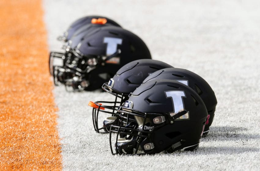 CHAMPAIGN, IL - OCTOBER 13: Illinois Fighting Illini helmets sit on the sidelines as players warm up for the Big Ten Conference college football game between the Purdue Boilermakers and the Illinois Fighting Illini on October 13, 2018, at Memorial Stadium in Champaign, Illinois. (Photo by Michael Allio/Icon Sportswire via Getty Images)
