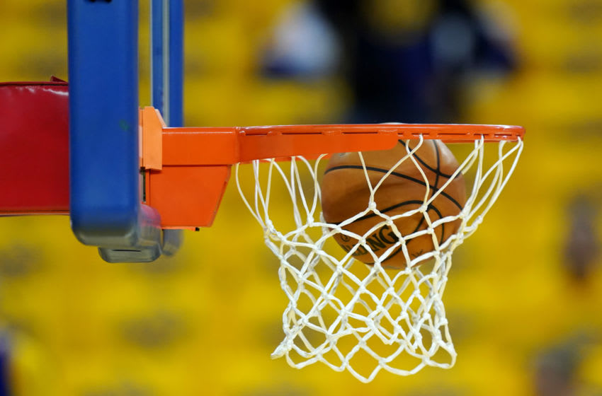 OAKLAND, CALIFORNIA - JUNE 13: A basketball is shot through the hoop during warmups prior to Game Six of the 2019 NBA Finals between the Golden State Warriors and the Toronto Raptors at ORACLE Arena on June 13, 2019 in Oakland, California. NOTE TO USER: User expressly acknowledges and agrees that, by downloading and or using this photograph, User is consenting to the terms and conditions of the Getty Images License Agreement. (Photo by Thearon W. Henderson/Getty Images)