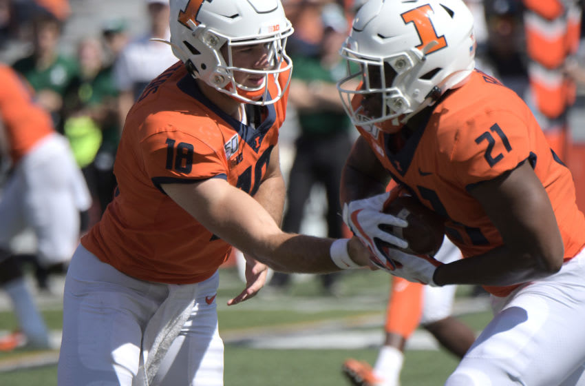 CHAMPAIGN, IL. - SEPTEMBER 14: Illinois quarterback Brandon Peters (18) hands off to Illinois running back Ra'von Bonner (21) during a non-conference college football game between the Eastern Michigan Eagles and the Illinois Fighting Illini on September 14, 2019, at Memorial Stadium, Champaign, IL. (Photo by Keith Gillett/Icon Sportswire via Getty Images)