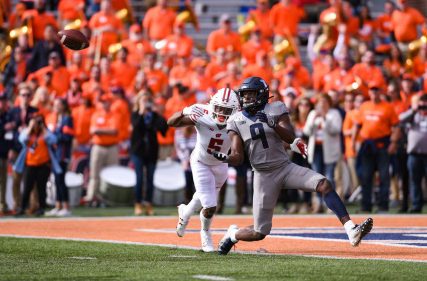 CHAMPAIGN, IL - OCTOBER 19: Illinois (WR) Josh Imatorbhebhe (9) catches a touchdown during a college football game between the Wisconsin Badgers and Illinois Fighting Illini on October 19, 2019 at Memorial Stadium in Champaign, IL (Photo by James Black/Icon Sportswire via Getty Images)