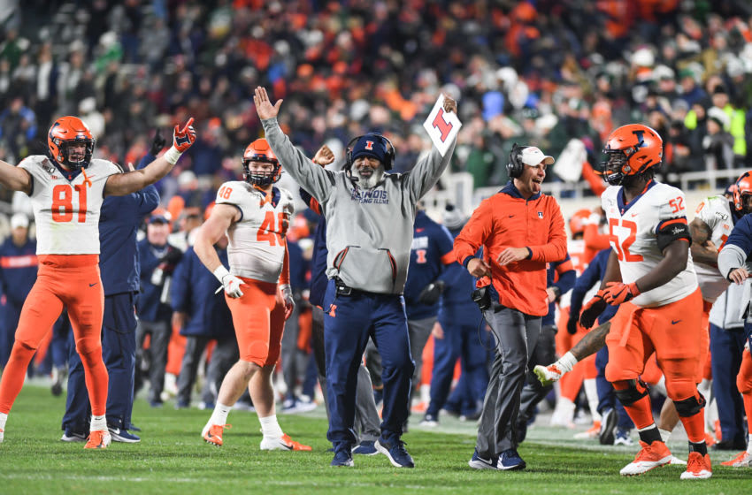 EAST LANSING, MI - NOVEMBER 09: Illinois head coach Lovie Smith signals for a touchdown after his team takes the lead during a college football game between the Michigan State Spartans and Illinois Fighting Illini on November 9, 2019 at Spartan Stadium in East Lansing, MI. (Photo by Adam Ruff/Icon Sportswire via Getty Images)