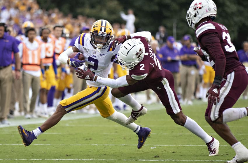 STARKVILLE, MS - OCTOBER 19: Justin Jefferson #2 of the LSU Tigers runs the ball and stiff arms Jarrian Jones #2 of the Mississippi State Bulldogs at Davis Wade Stadium on October 19, 2019 in Starkville, Mississippi. The Tigers defeated the Bulldogs 36-13. (Photo by Wesley Hitt/Getty Images)