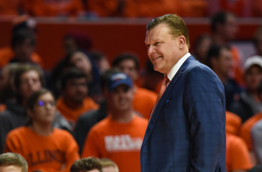 CHAMPAIGN, IL - NOVEMBER 18: Illinois head coach Brad Underwood smiles during a time out in a huddle during a college basketball game between the Hawaii Rainbow Warriors and Illinois Fighting Illini on November 18, 2018 at the State Farm Center in Champaign, Ill (Photo by James Black/Icon Sportswire via Getty Images)