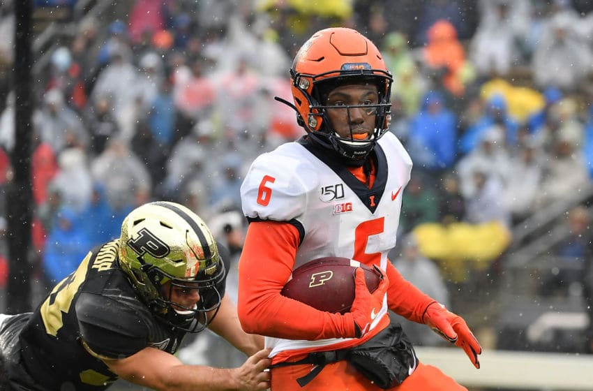 WEST LAFAYETTE, INDIANA - OCTOBER 26: Tony Adams #6 of the Illinois Fighting Illini scores a touchdown after his interception in the first half against the Purdue Boilermakers at Ross-Ade Stadium on October 26, 2019 in West Lafayette, Indiana. (Photo by Quinn Harris/Getty Images)
