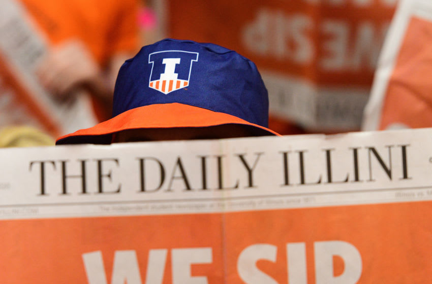 CHAMPAIGN, IL - JANUARY 30: A member of the Orange Crush student section reads the Daily Illini student newspaper before the start of the Big Ten Conference college basketball game between the Minnesota Golden Gophers and the Illinois Fighting Illini on January 30, 2020, at the State Farm Center in Champaign, Illinois. (Photo by Michael Allio/Icon Sportswire via Getty Images)