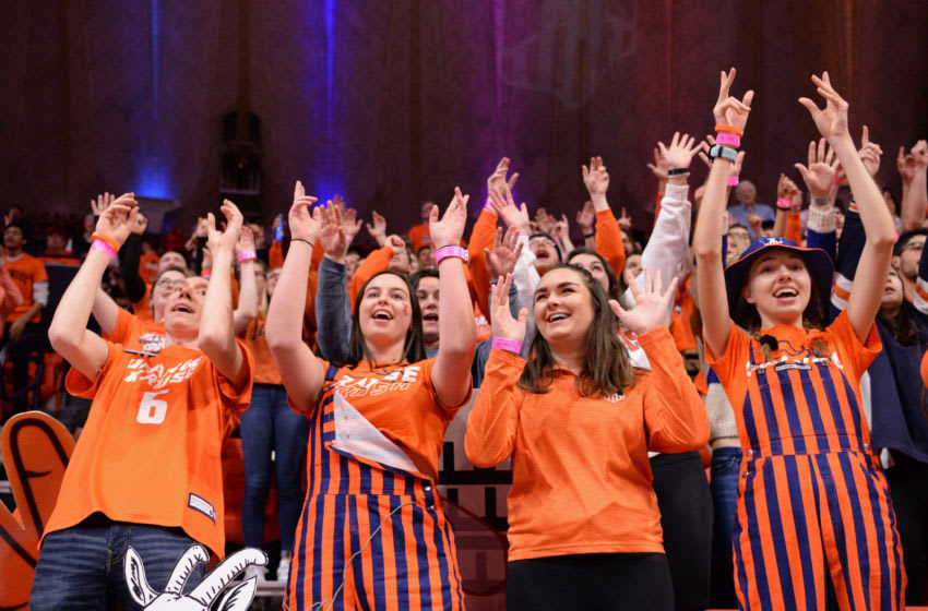CHAMPAIGN, IL - JANUARY 30: The Orange Crush student section cheers during the Big Ten Conference college basketball game between the Minnesota Golden Gophers and the Illinois Fighting Illini on January 30, 2020, at the State Farm Center in Champaign, Illinois. (Photo by Michael Allio/Icon Sportswire via Getty Images)