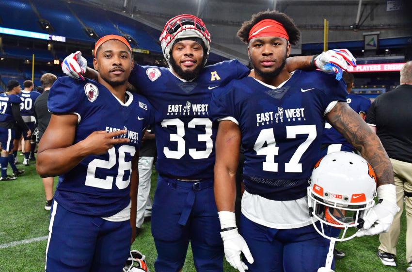 ST PETERSBURG, FLORIDA - JANUARY 18: Reggie Corbin #26 from Illinois, Patrick Nelson #33 from SMU and Dele Harding #47 from The University of Illinois playing for the West Team pose for a picture after the 2019 East-West Shrine Game at Tropicana Field on January 18, 2020 in St Petersburg, Florida. (Photo by Julio Aguilar/Getty Images)
