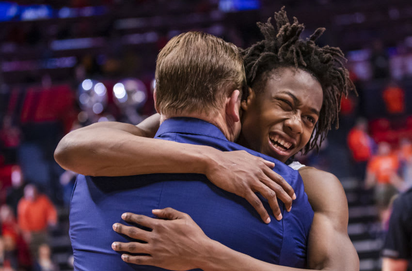 CHAMPAIGN, IL - MARCH 08: Head coach Brad Underwood and Ayo Dosunmu #11 of the Illinois Fighting Illini embrace following the game against the Iowa Hawkeyes at State Farm Center on March 8, 2020 in Champaign, Illinois. (Photo by Michael Hickey/Getty Images)