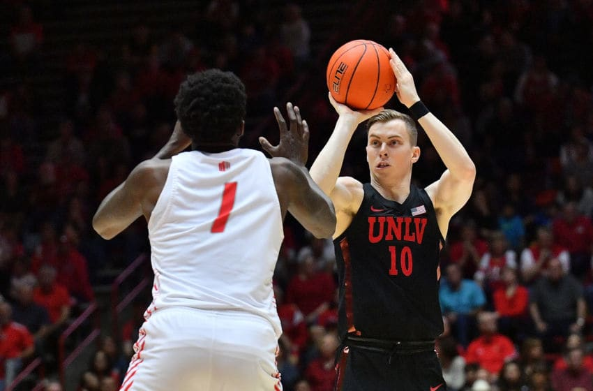 ALBUQUERQUE, NEW MEXICO - FEBRUARY 15: Jonah Antonio #10 of the UNLV Rebels shoots against Corey Manigault #1 of the New Mexico Lobos during their game at Dreamstyle Arena - The Pit on February 15, 2020 in Albuquerque, New Mexico. (Photo by Sam Wasson/Getty Images)