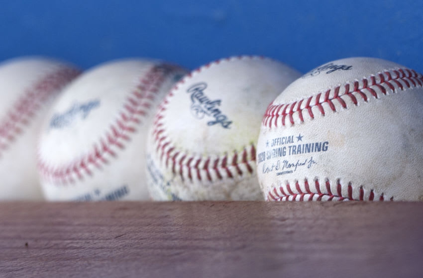 GLENDALE, ARIZONA - MARCH 08: A general view of a group of official Major League Baseball Spring Training baseballs as pictured in the visitors dugout, during the game between the Chicago White Sox and Kansas City Royals on March 8, 2020 at Camelback Ranch in Glendale Arizona. (Photo by Ron Vesely/Getty Images)