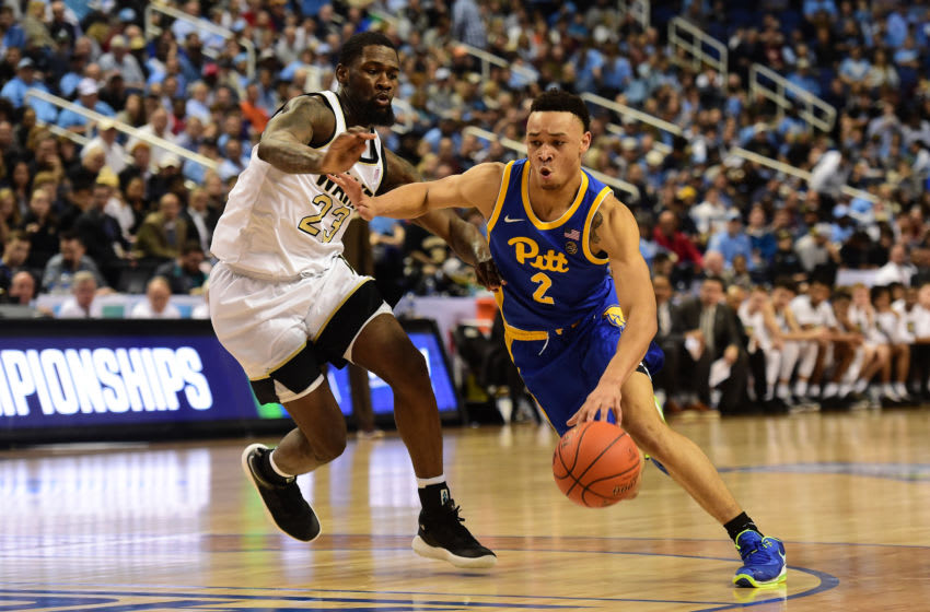 GREENSBORO, NORTH CAROLINA - MARCH 10: Trey McGowens #2 of the Pittsburgh Panthers drives to the basket against Chaundee Brown #23 of the Wake Forest Demon Deacons during their game in the first round of the 2020 Men's ACC Basketball Tournament at Greensboro Coliseum on March 10, 2020 in Greensboro, North Carolina. (Photo by Jared C. Tilton/Getty Images)