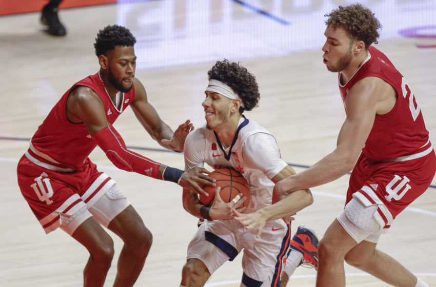 CHAMPAIGN, IL - DECEMBER 26: Andre Curbelo #5 of the Illinois Fighting Illini drives to the basket between Al Durham #1 and Race Thompson #25 of the Indiana Hoosiers during the second half at State Farm Center on December 26, 2020 in Champaign, Illinois. (Photo by Michael Hickey/Getty Images)