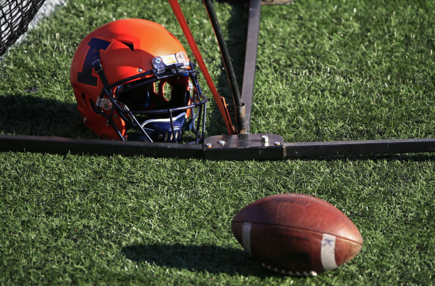 PISCATAWAY, NJ - NOVEMBER 14: An Illinois Fighting Illini helmet lies on the turf against the Rutgers Scarlet Knights during the first quarter at SHI Stadium on November 14, 2020 in Piscataway, New Jersey. Illinois defeated Rutgers 23-20. (Photo by Corey Perrine/Getty Images)