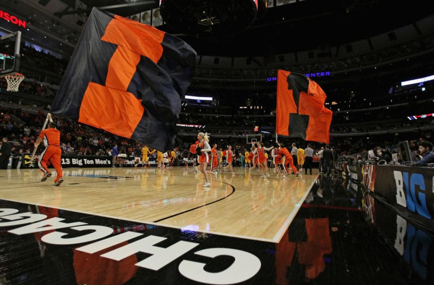 CHICAGO - MARCH 14: The Illinois Fighting Illini cheer team runs around the court against the Minnesota Golden Gophers during a first round game of the Big Ten Basketball Tournament at the United Center on March 14, 2013 in Chicago, Illinois. Illinois defeated Minnesota 51-49. (Photo by Jonathan Daniel/Getty Images)