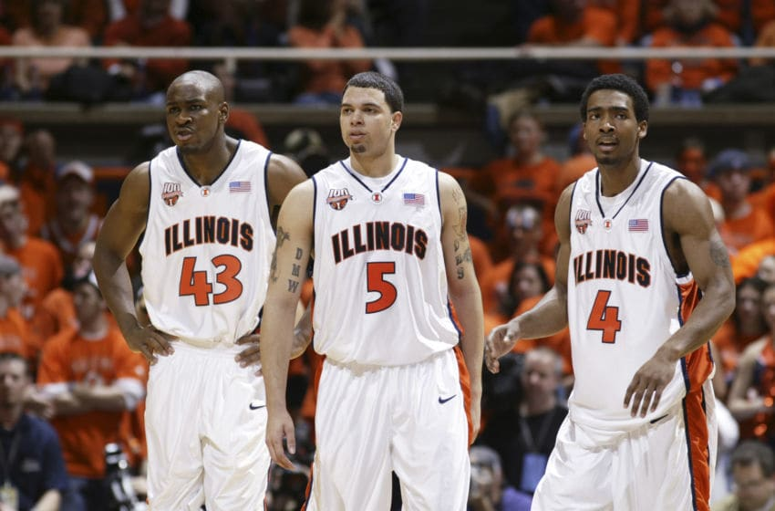 CHAMPAIGN, IL - FEBRUARY 12: Roger Powell Jr. #43, Deron Williams #5 and Luther Head #4 of the Illinois Fighting Illini look on during a game against the Wisconsin Badgers at Assembly Hall on February 12, 2005 in Champaign, Illinois. Illinois defeated Wisconsin 70-59 during their run to the Final Four. (Photo by Joe Robbins/Getty Images)
