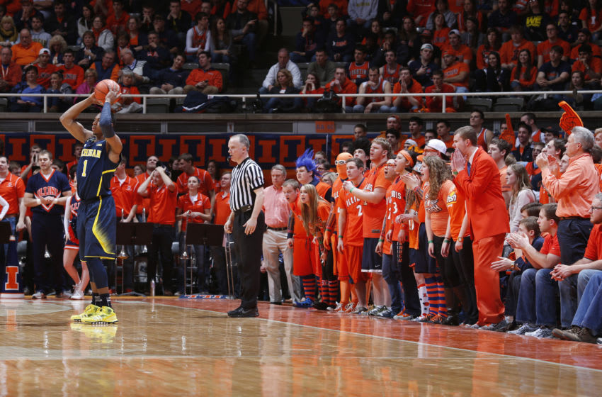 CHAMPAIGN, IL - MARCH 4: Illinois Fighting Illini fans from the Orange Krush try to distract Glenn Robinson III #1 of the Michigan Wolverines during the game at State Farm Center on March 4, 2014 in Champaign, Illinois. Michigan defeated Illinois 84-53. (Photo by Joe Robbins/Getty Images)