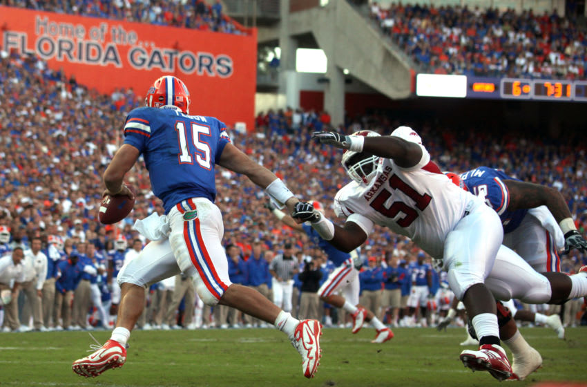 17 OCT 2009: Quarterback Tim Tebow (15) of the Gators gets around Alfred Davis (51) of Arkansas during the game between the Arkansas Razorbacks and the Florida Gators at Ben Hill Griffin Stadium in Gainesville, Florida. (Photo by Cliff Welch/Icon SMI/Corbis/Icon Sportswire via Getty Images)
