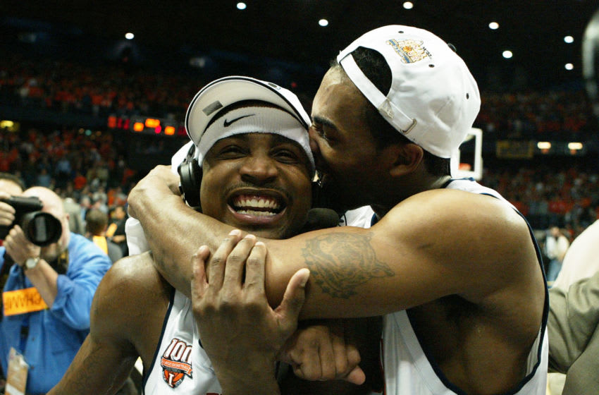 CHICAGO - MARCH 26: Luther Head #4 of the Illinois Fighting Illini kisses teammate Dee Brown #11, L, as they celebrate victory over the Arizona Wildcats in the Chicago Regional Final in the NCAA Division I Men's Basketball Championship at the Allstate Arena on March 26, 2005 in Chicago, Illinois. Illinois defeated Arizona 90-89 in overtime. (Photo by Doug Benc/Getty Images)