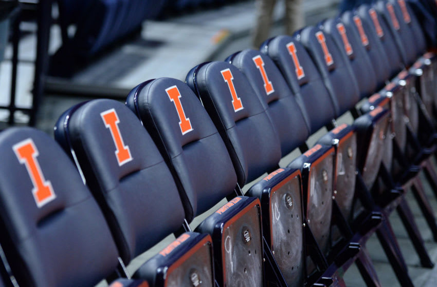 CHAMPAIGN, IL - NOVEMBER 19: The Illinois Fighting Illini logo is seen on courtside seats before the start of the college basketball game between the Marshall Thundering Herd and the Illinois Fighting Illini on November 19, 2017, at the State Farm Center in Champaign, Illinois. (Photo by Michael Allio/Icon Sportswire via Getty Images)