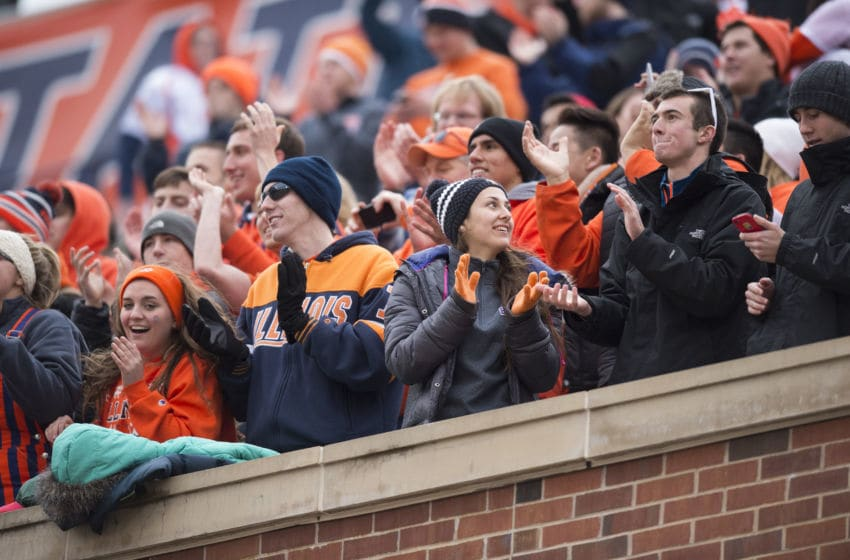 November 22, 2014: University of Illinois' fans celebrate a 16-14 win over Penn State at Memorial Stadium in Champaign, IL. (Photo by Paul Bergstrom/Icon Sportswire/Corbis via Getty Images)