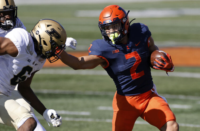 CHAMPAIGN, IL - OCTOBER 31: Chase Brown #2 of the Illinois Fighting Illini runs with the ball against the Purdue Boilermakers in the third quarter at Memorial Stadium on October 31, 2020 in Champaign, Illinois. Purdue defeated Illinois 31-24. (Photo by Joe Robbins/Getty Images)