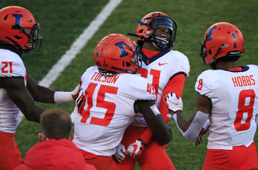 PISCATAWAY, NJ - NOVEMBER 14: Devon Witherspoon #31 of the Illinois Fighting Illini celebrates his interception against the Rutgers Scarlet Knights with teammate Khalan Tolson #45, Jartavius Martin #21 and Nate Hobbs #8 during the fourth quarter at SHI Stadium on November 14, 2020 in Piscataway, New Jersey. Illinois defeated Rutgers 23-20. (Photo by Corey Perrine/Getty Images)