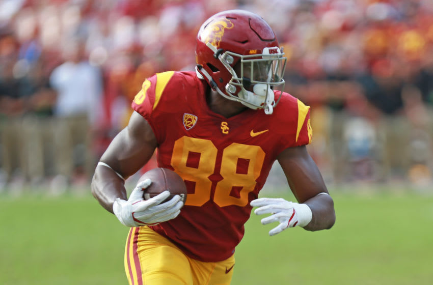 LOS ANGELES, CA - SEPTEMBER 02: Daniel Imatorbhebhe #88 of the USC Trojans handles the ball against the Western Michigan Broncos in a Trojan 49-31 win at Los Angeles Memorial Coliseum on September 2, 2017 in Los Angeles, California. (Photo by Leon Bennett/Getty Images)