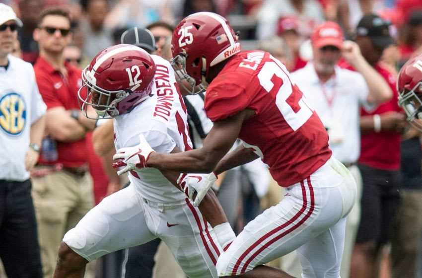 Defensive back Eddie Smith (25) stops wide receiver Chadarius Townsend (12) during second half action in the Alabama A-Day spring football scrimmage game at Bryant Denny Stadium in Tuscaloosa, Ala., on Saturday April 13, 2019. Bama13