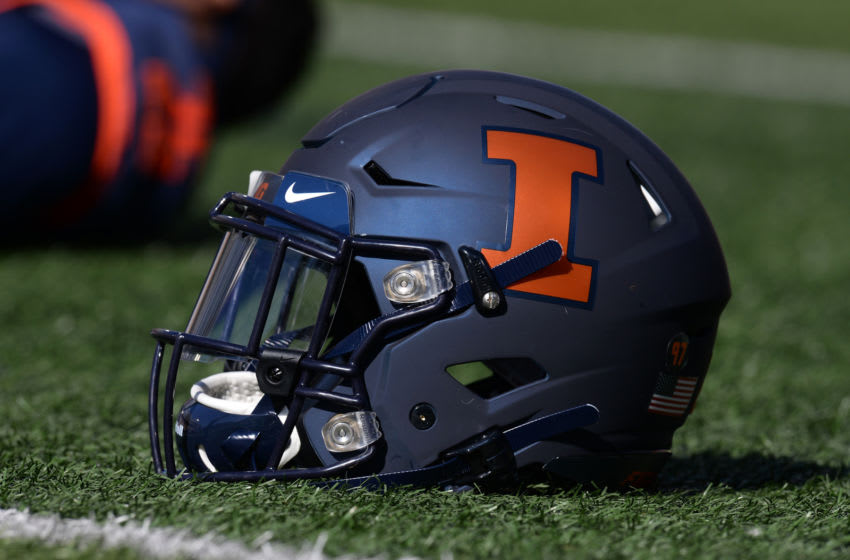 Oct 12, 2019; Champaign, IL, USA; An Illinois Fighting Illini helmet sits on the field as players stretch before the start of the game between the Illinois Fighting Illini and the Michigan Wolverines at Memorial Stadium. Mandatory Credit: Michael Allio-USA TODAY Sports