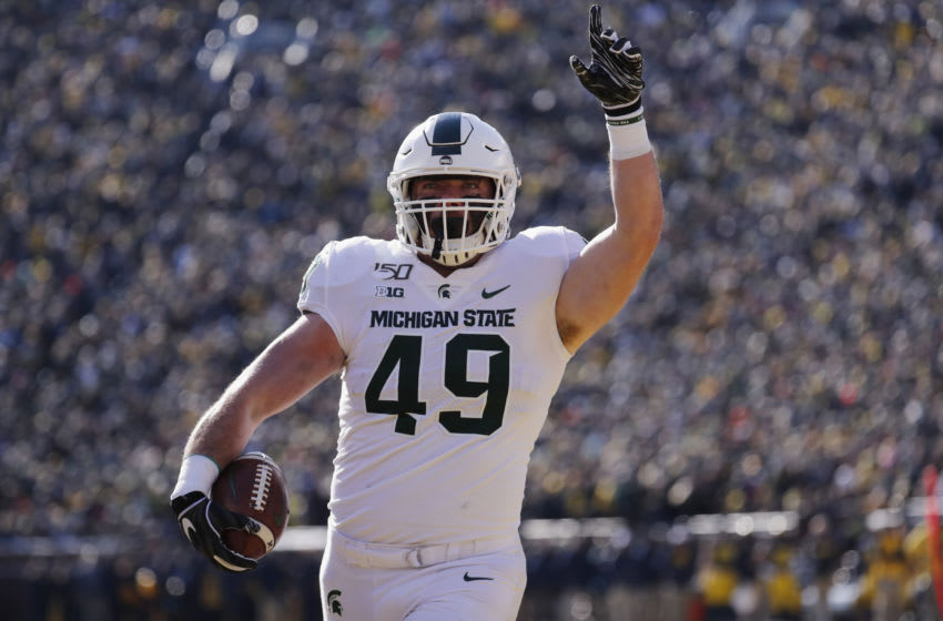 Nov 16, 2019; Ann Arbor, MI, USA; Michigan State Spartans fullback Max Rosenthal (49) scores a touchdown in the first half against the Michigan Wolverines at Michigan Stadium. Mandatory Credit: Rick Osentoski-USA TODAY Sports