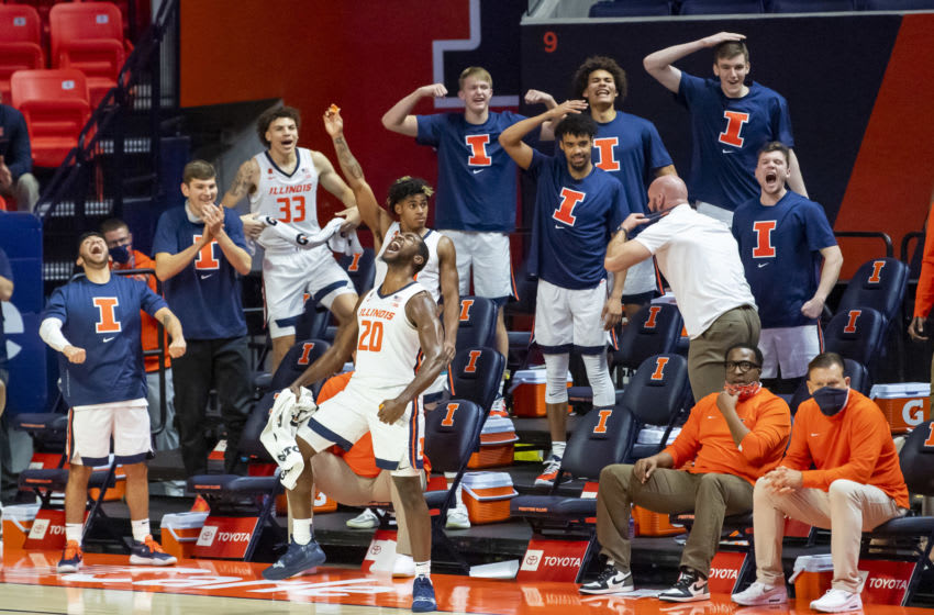 Dec 15, 2020; Champaign, Illinois, USA; Illinois Fighting Illini guard Da'Monte Williams (20) and the bench celebrates during the second half against the Minnesota Golden Gophers at the State Farm Center. Mandatory Credit: Patrick Gorski-USA TODAY Sports
