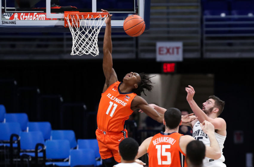 Dec 23, 2020; University Park, Pennsylvania, USA; Illinois Fighting Illini guard Ayo Dosunmu (11) is fouled by Penn State Nittany Lions forward Trent Buttrick (15) during the second half at Bryce Jordan Center. Illinois defeated Penn State 98-81. Mandatory Credit: Matthew OHaren-USA TODAY Sports